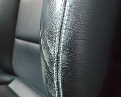 VOOR: Instapschade bestuurdersstoel zwart lederen interieur van Mercedes Break